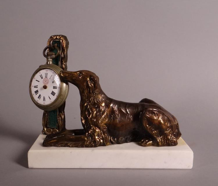 Clocks: bronze watch stand -dog lying- with pocket watch