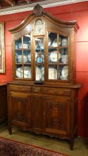Furniture: 2 pieces cabinet in carved oak with clock