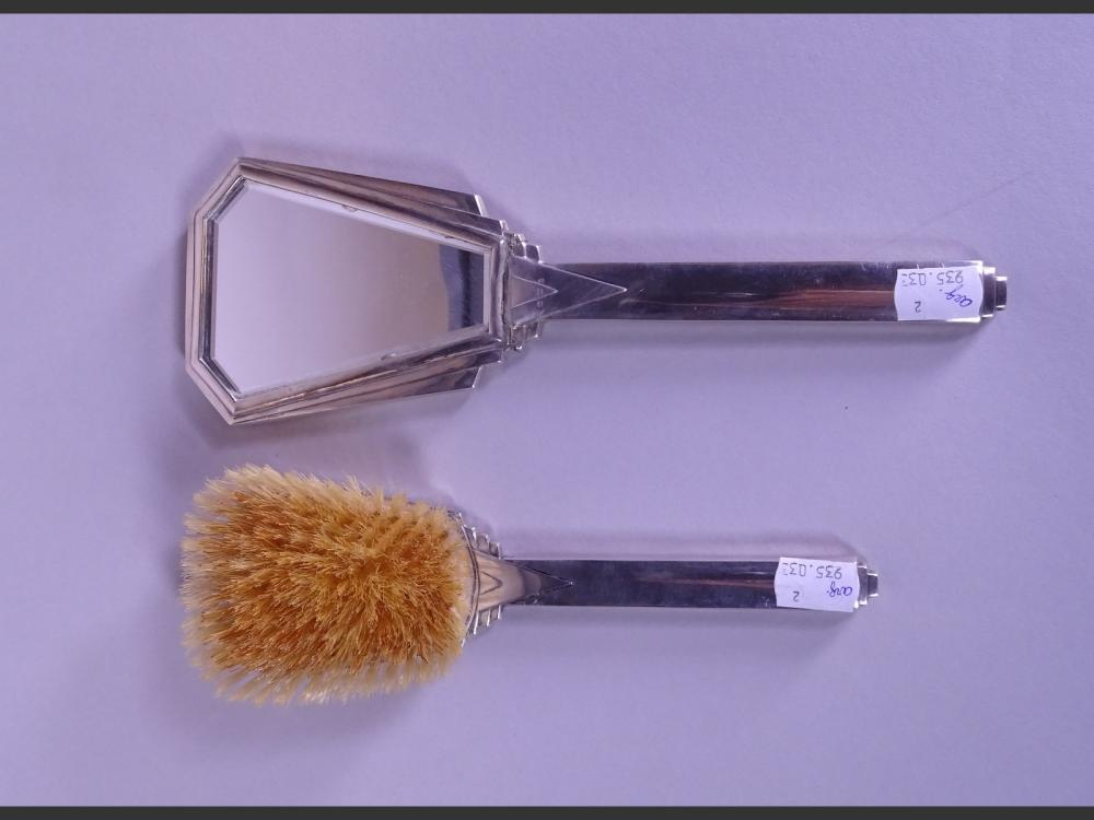 Silverware: (2) Art Deco hand face and brush in German silver