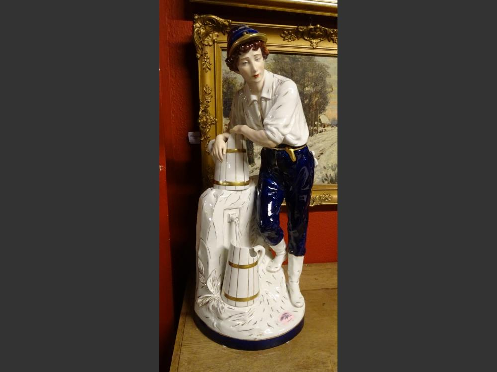 Ceramic: Royal Dux porcelain with pastille - Man at the fountain - blue heightened with gold 1st half of the 20th C.