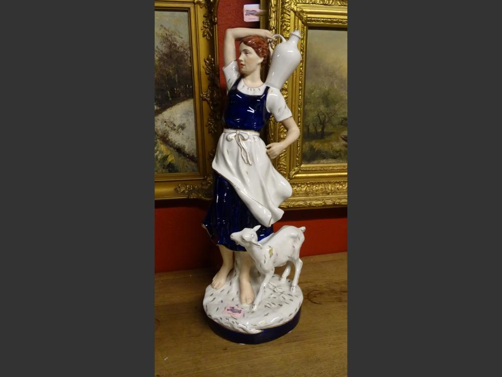 Ceramic: Royal Dux porcelain with pastille - Young farmer and her goat - blue heightened with gold 1st half of the 20th C.