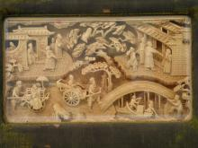 Framed Chinese wood carving.