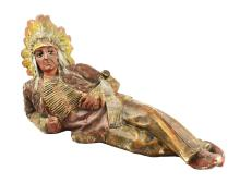 Chalk Lying Down Cigar Store Indian.