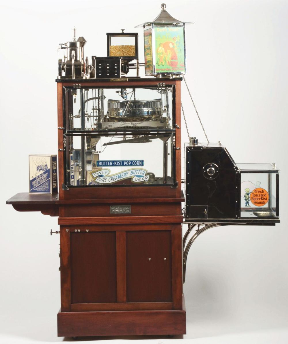 HOLCOMB & HOKE BUTTER KIST PORCORN MACHINE WITH ACCESSORIES AND MANNEQUIN.