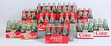 Lot of Coca-Cola Bottles with Cardboard Carriers.
