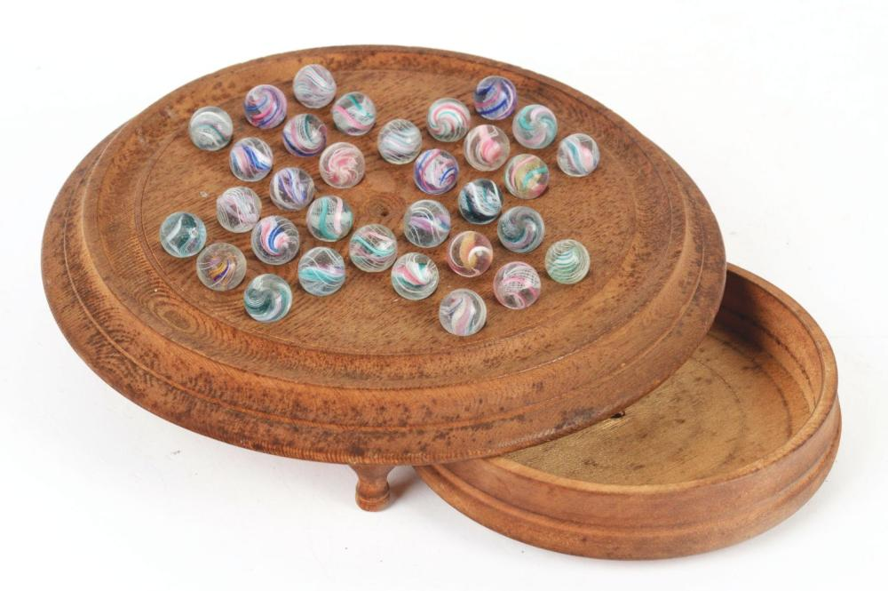 Lot 2003: Solitaire Board of Marbles with Original German Swirls.