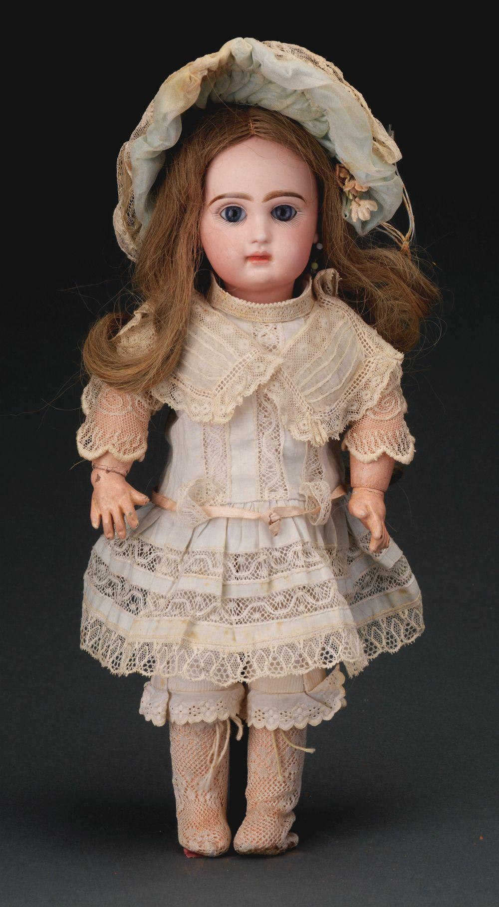 Lot 2053: Pretty Cabinet Sized Jumeau Bebe.