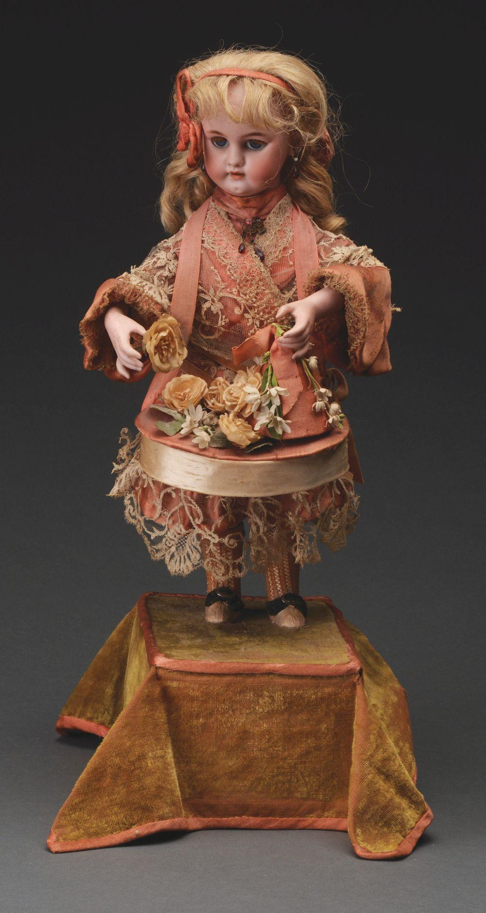 Lot 2057: French Musical Automaton Doll in Display Case.