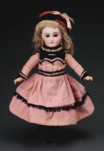 Lot 2073: Lovely Closed Mouth Early German Doll.