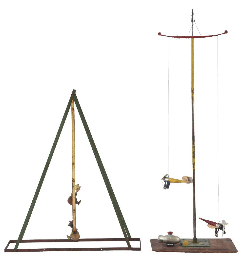 Lot 2109: Lot of 2: Early Swing Toys.