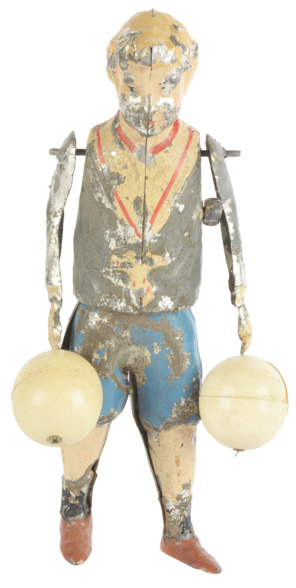 German Hand-Painted Wind-Up Balloon Boy.