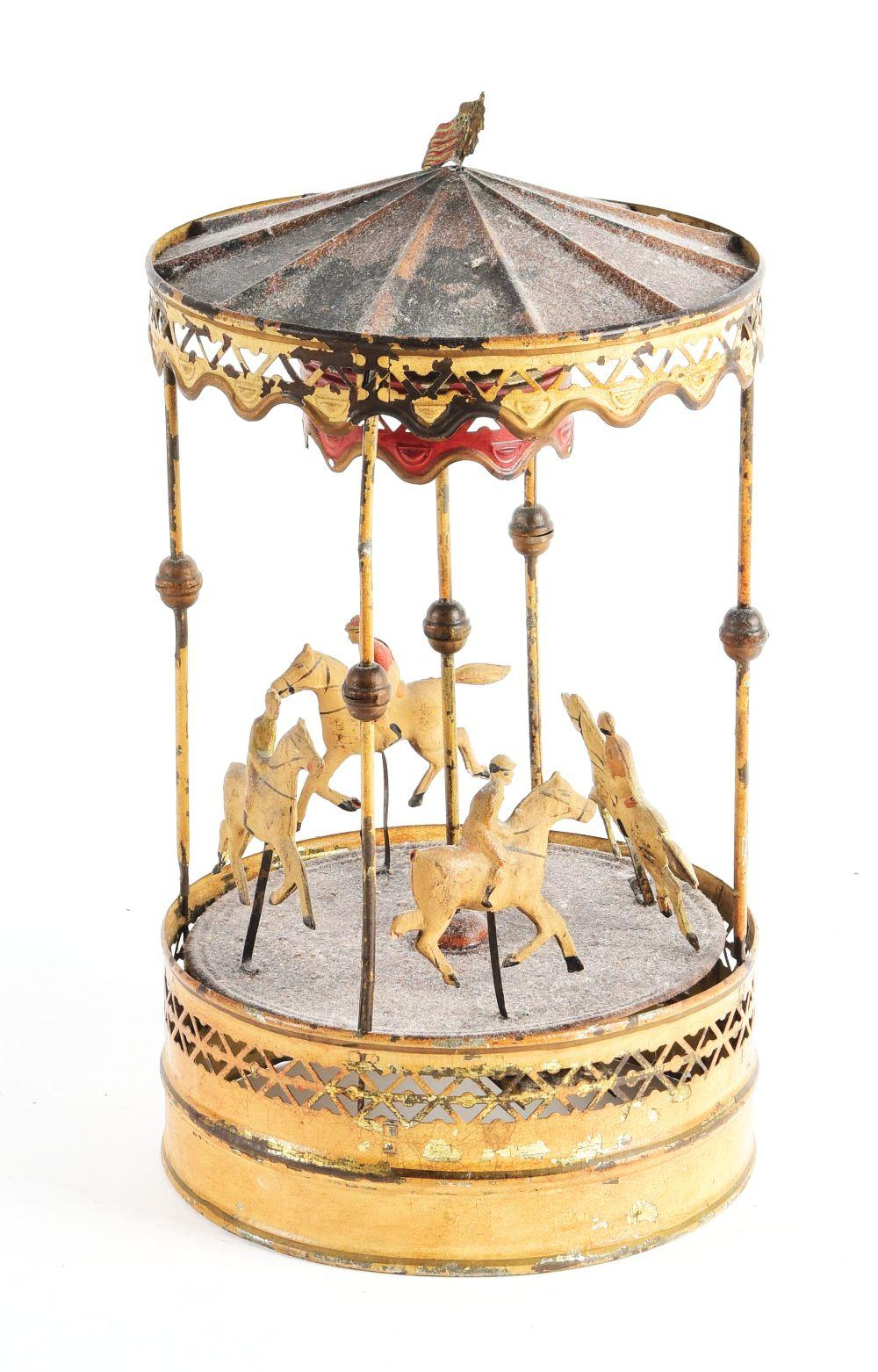 Lot 2131: German Tin Hand-Painted Carousel Toy.