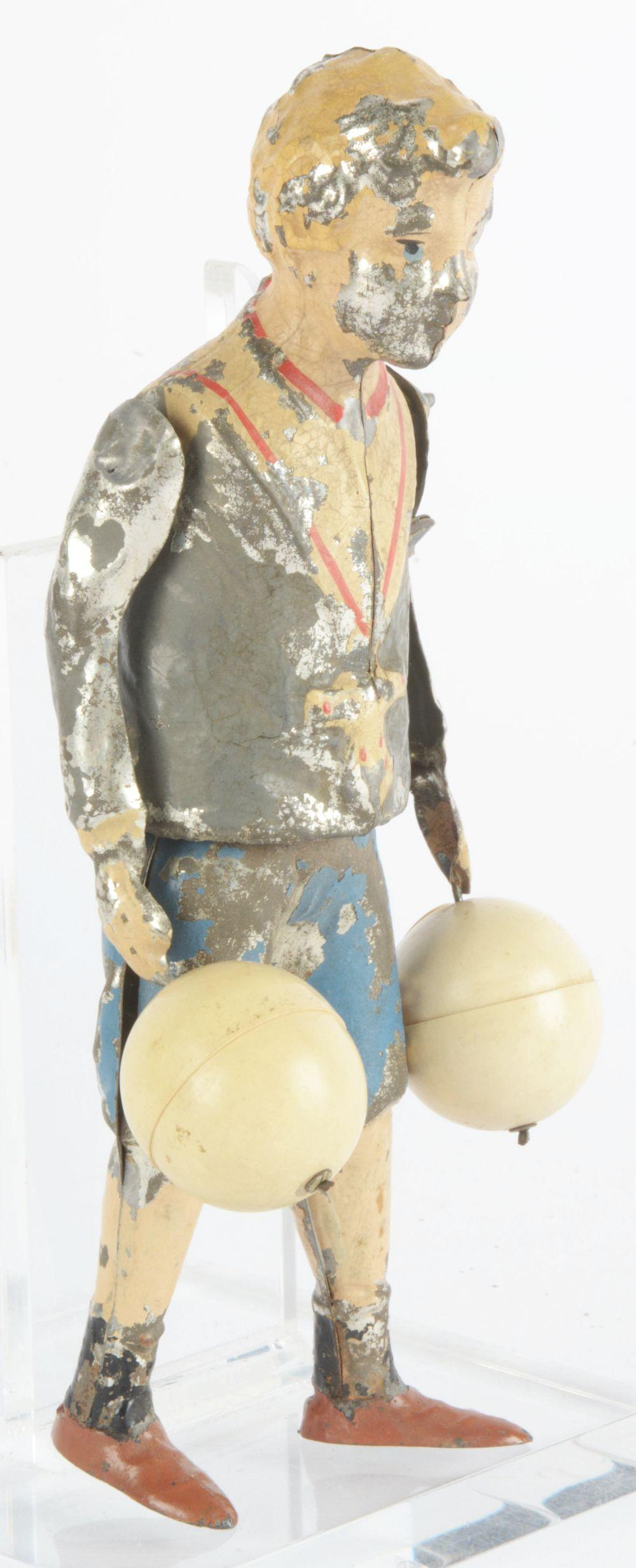 Lot 2132: German Hand-Painted Wind-Up Balloon Boy.