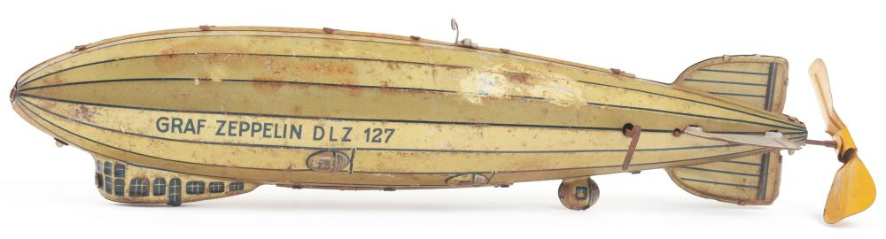 Lot 2139: German Tin-Litho Wind-Up Tippco Zeppelin Toy.