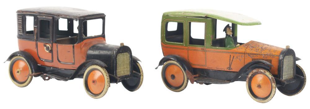 Lot 2144: Lot of 2: German Tin-Litho G&K Wind-Up Automobile Toys.