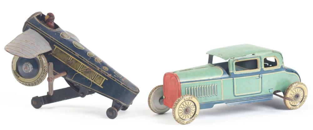 Lot 2145: Lot of 2: German Tin-Litho Wind-Up Transportation Toys.