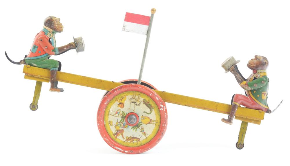 Lot 2152: German Dissler Tin-Litho Wind-Up Monkey Seesaw Toy.