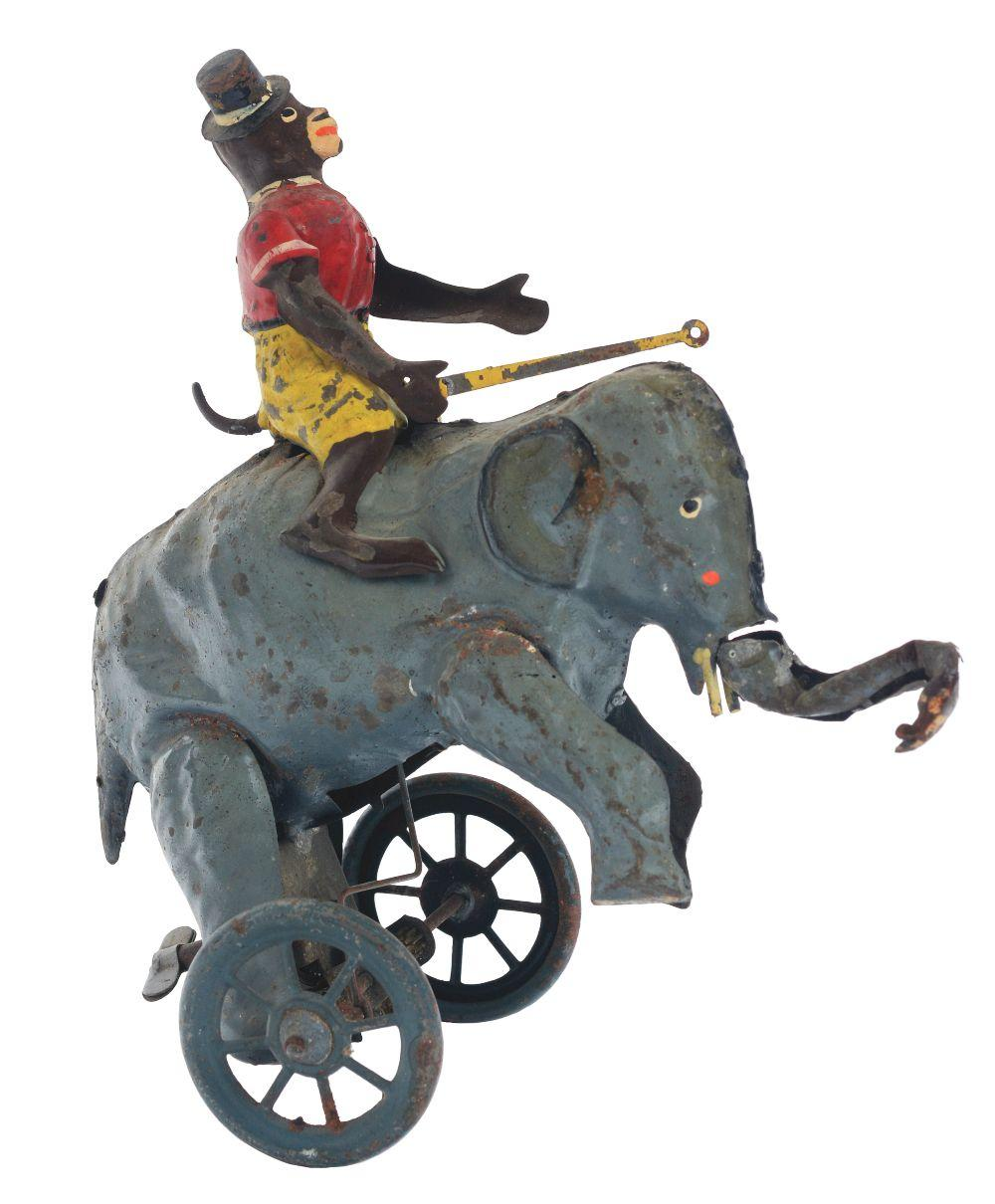 German Hand-Painted Wind-Up Monkey Riding Elephant Toy.