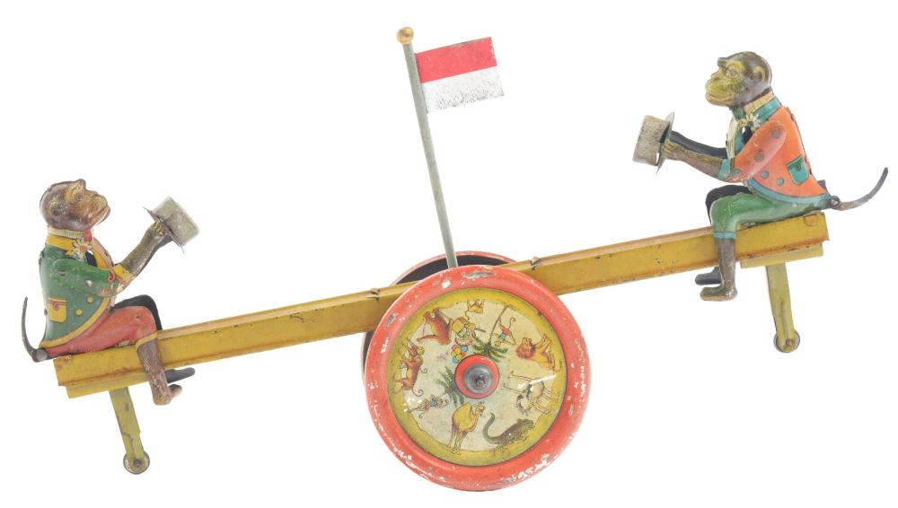 German Dissler Tin-Litho Wind-Up Monkey Seesaw Toy.
