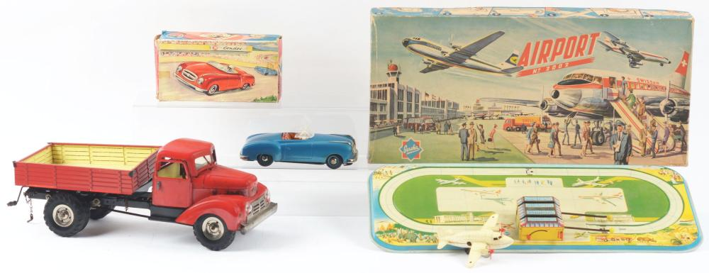 Lot 2146: Lot of 3: German Tin-Litho & Plastic Wind-Up Transportation Toys.