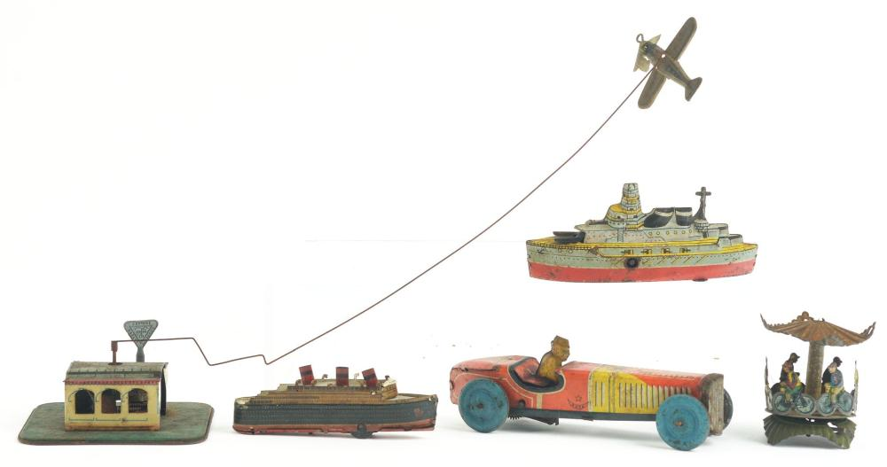 Lot 2148: Lot of 5: German & Japanese Tin-Litho Transportation Toys.