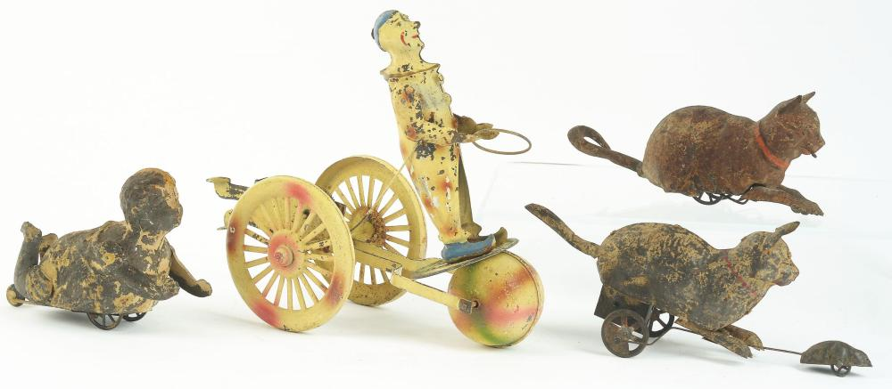 Lot 2147: Lot of 4: German Hand-Painted Wind-Up Toys.