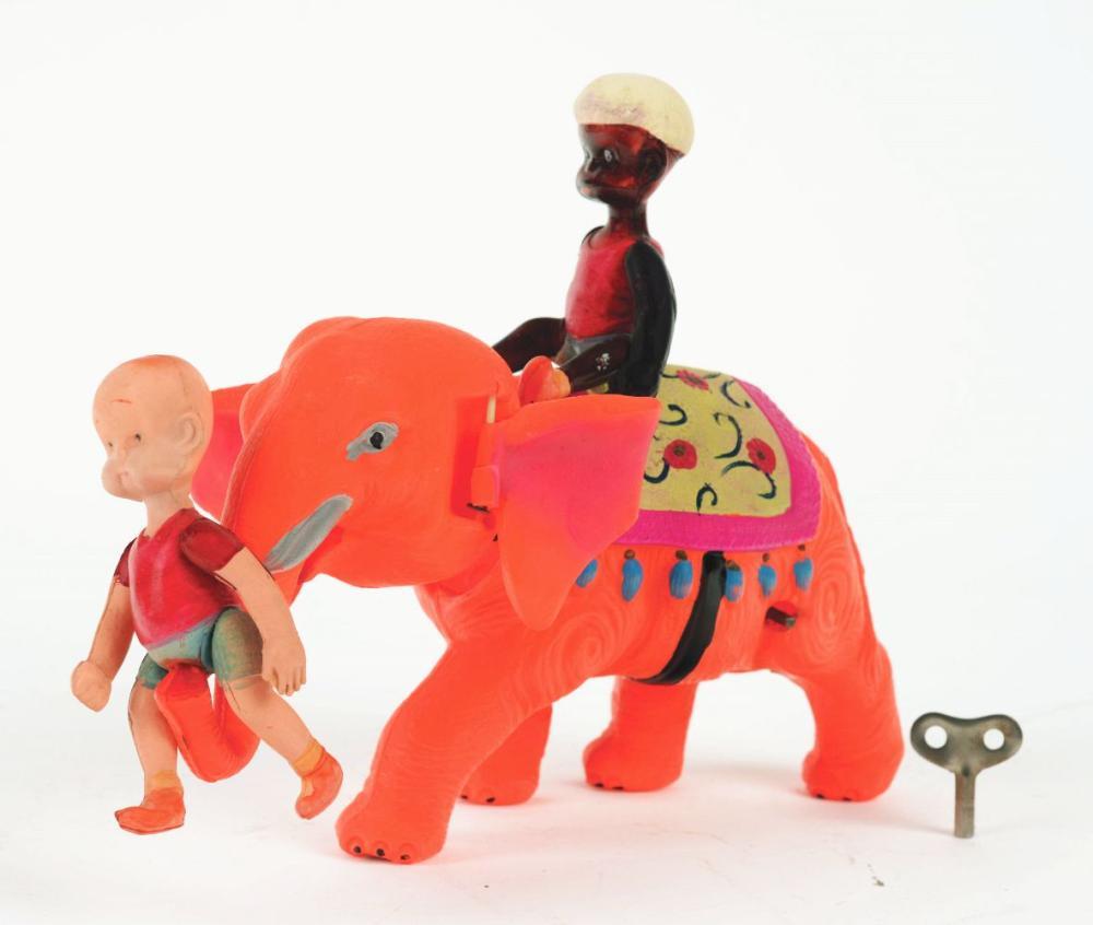 Lot 2183: Pre-War Japanese Celluloid Wind-Up Henry on Clockwork Elephant Toy.