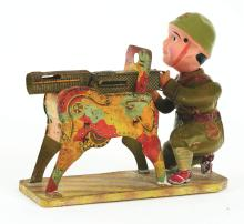 Lot 2184: Scarce Pre-War Japanese Tin-Litho and Celluloid Machinegunner Toy.