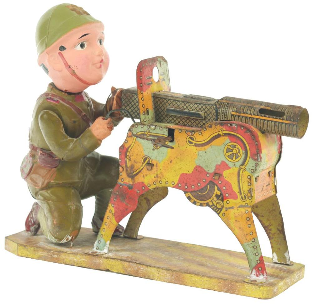 Scarce Pre-War Japanese Tin-Litho and Celluloid Machinegunner Toy.