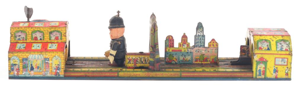 Lot 2210: Japanese Pre-War Tin-Litho & Celluloid Wind-Up Main St. Type Toy.