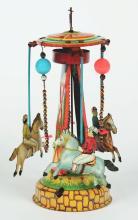 Lot 2218: Tin-Litho Large Wind-Up Pre-War Japan Horse Race Carousel.