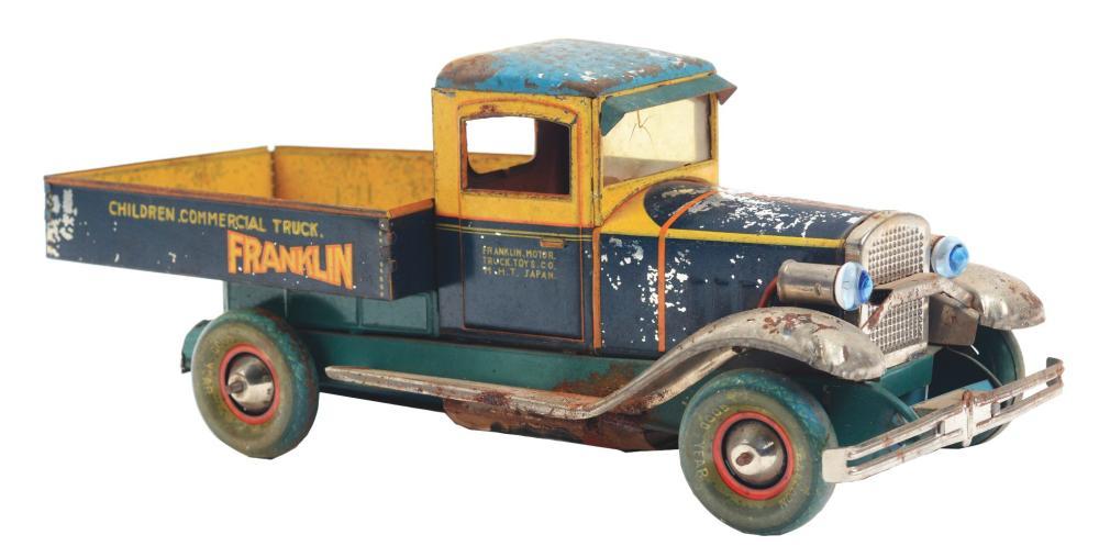 Lot 2228: Japanese Pre-War Tin-Litho Wind-Up Dump Truck Toy.