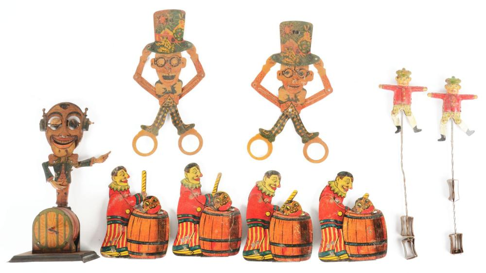 Lot 2234: Lot of 9: Various German & Japanese Tin-Litho Clicker & Amusement-Type Squeeze Toys.