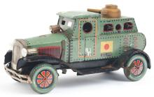Lot 2241: Japanese Pre-War Tin-Litho Armored Car Toy.