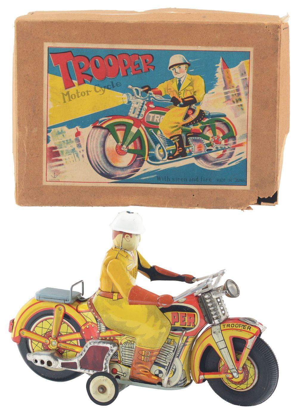 Lot 2247: Japanese Tin-Litho Friction Trooper Motorcycle Toy with Box.