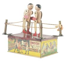 Lot 2251: Strauss Tin-Litho Knock Out Wind Up Toy.