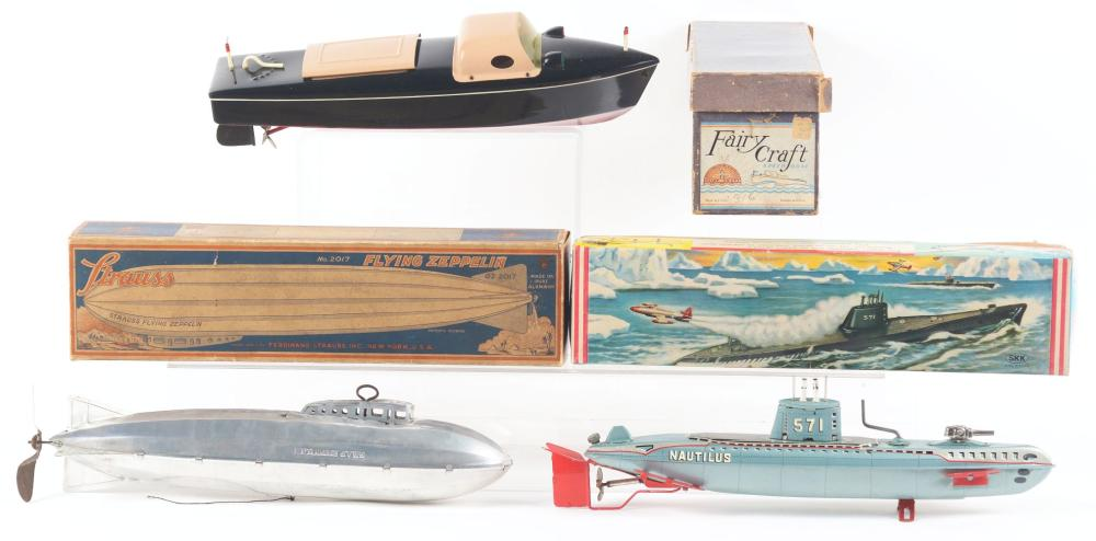Lot 2269: Lot of 3: American Made Tin-Litho & Plastic Ship & Zeppelin Toys.