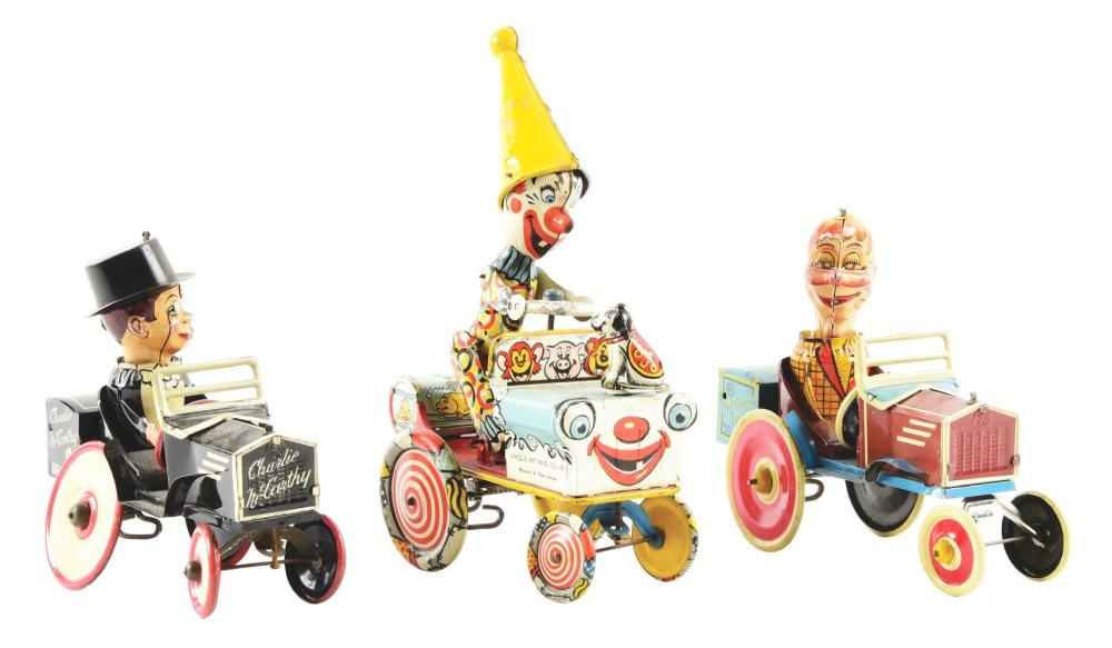Lot 2284: Lot of 3: American Made Tin-Litho Wind-Up Whoopee Car Character Toys.