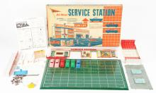 Lot 2309: Lot of 3: Pressed Steel & Plastic American Made Service Station Play Sets.