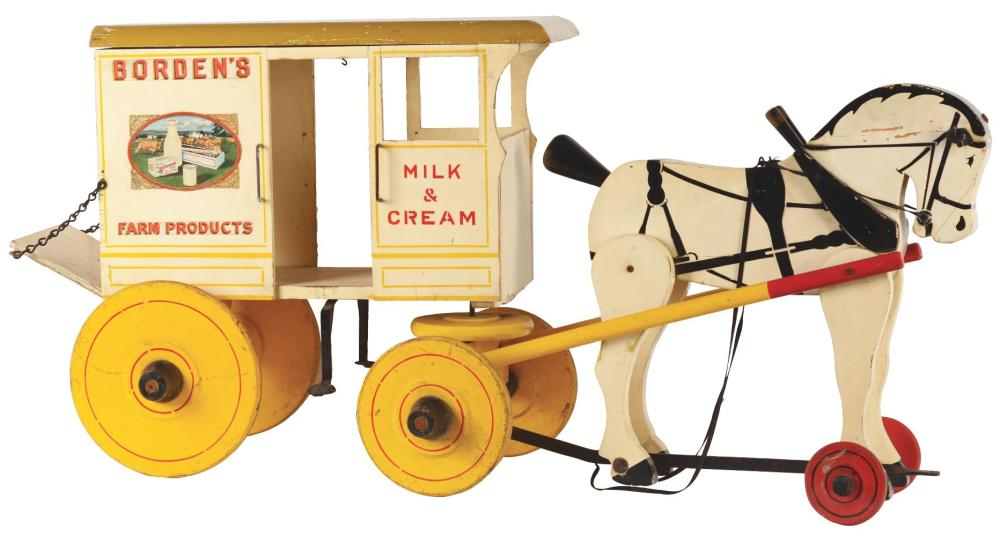 Lot 2318: Rare Large Size Rich Toys Horse-Drawn Borden's Farm Products Wagon.