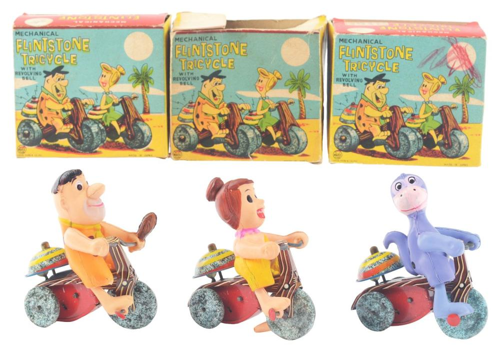 Lot 2330: Lot of 3: Marx Tin-Litho Wind-Up & Celluloid Flintstone Tricycle Toys.