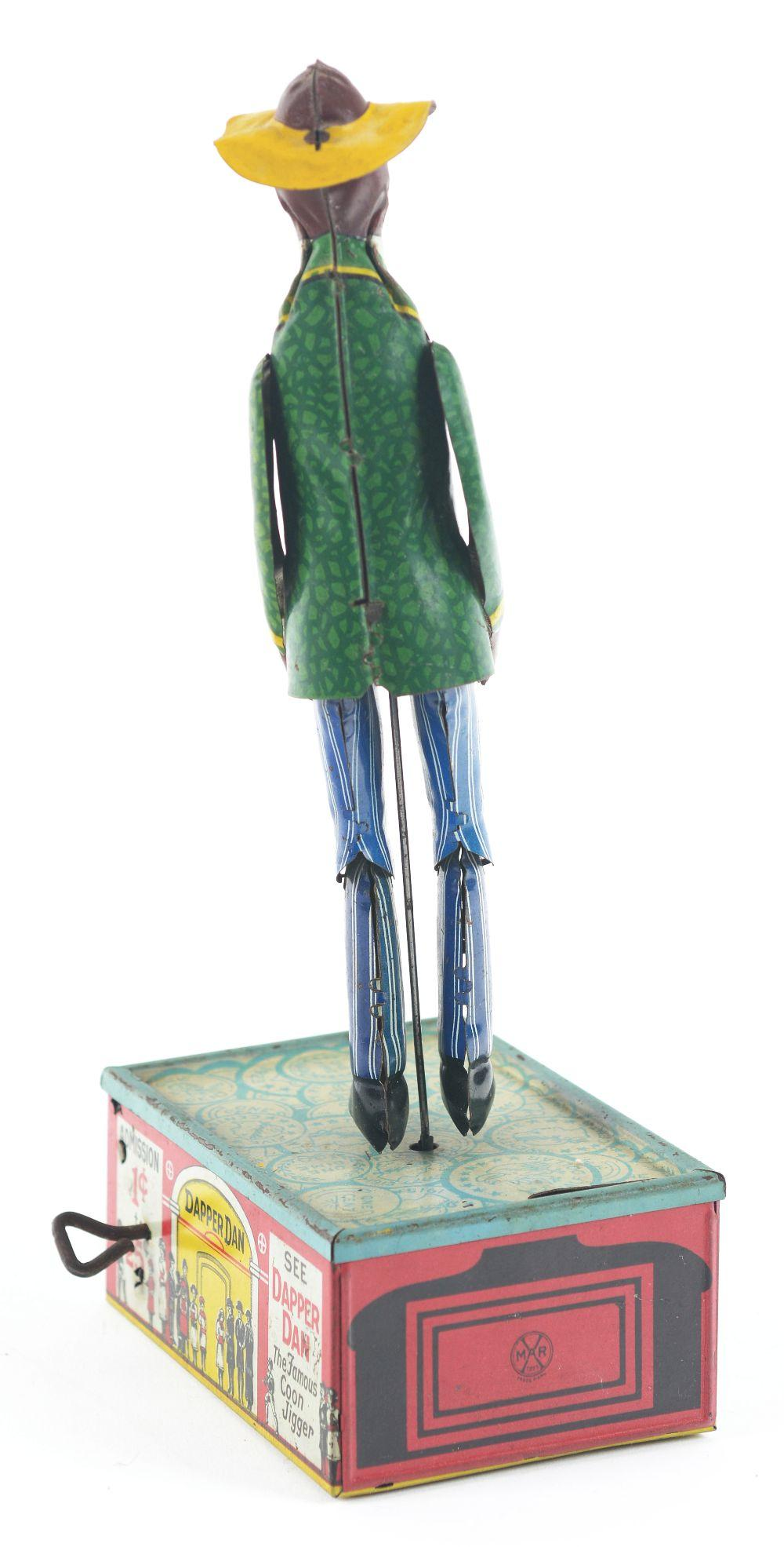 Lot 2329: Scarce Marx Tin-Litho Wind-Up Dapper Dan Dancing Coin Bank Toy.