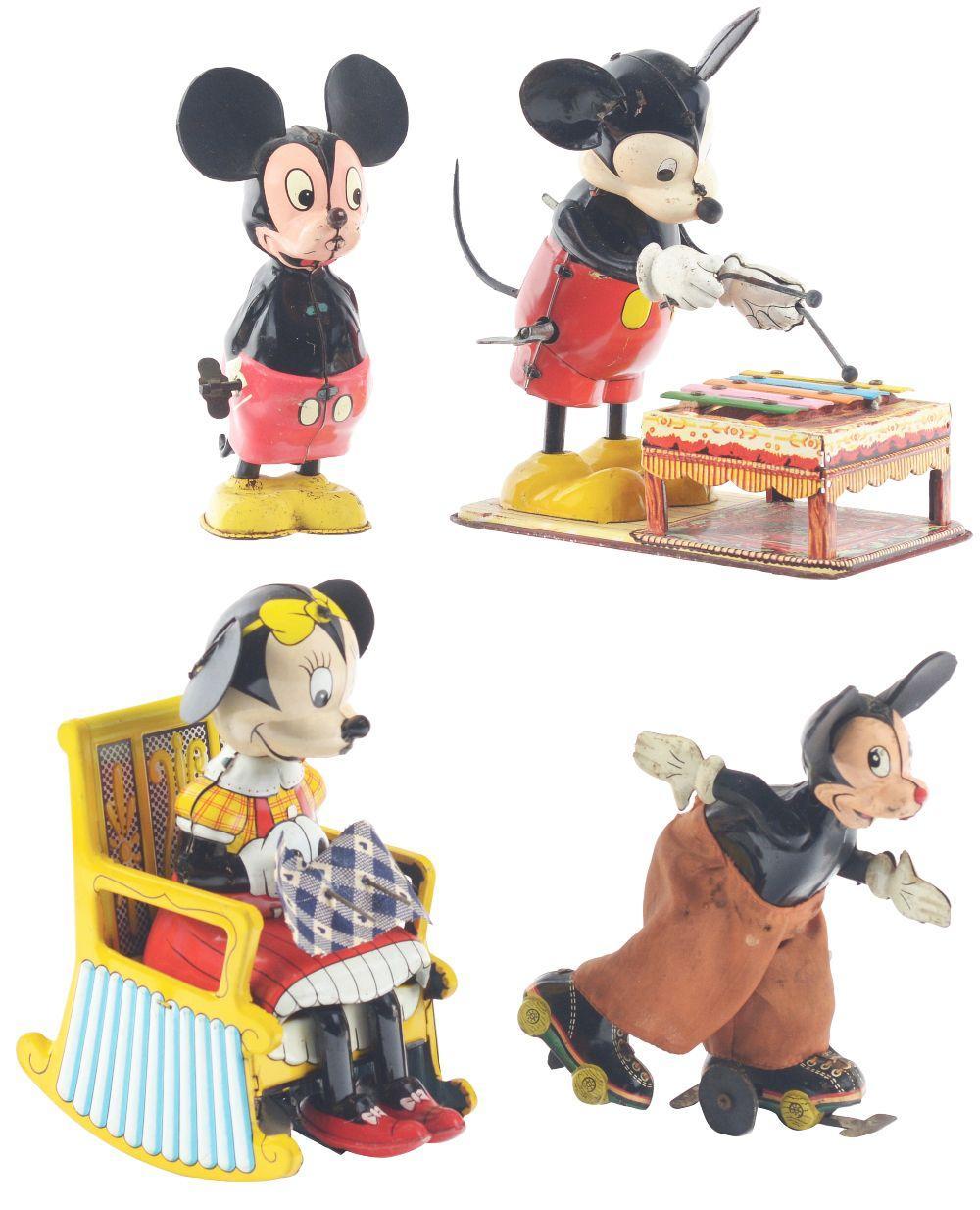 Lot 2341: Lot of 4: Marx Walt Disney Tin-Litho Wind-Up Mickey & Minnie Mouse Toys.