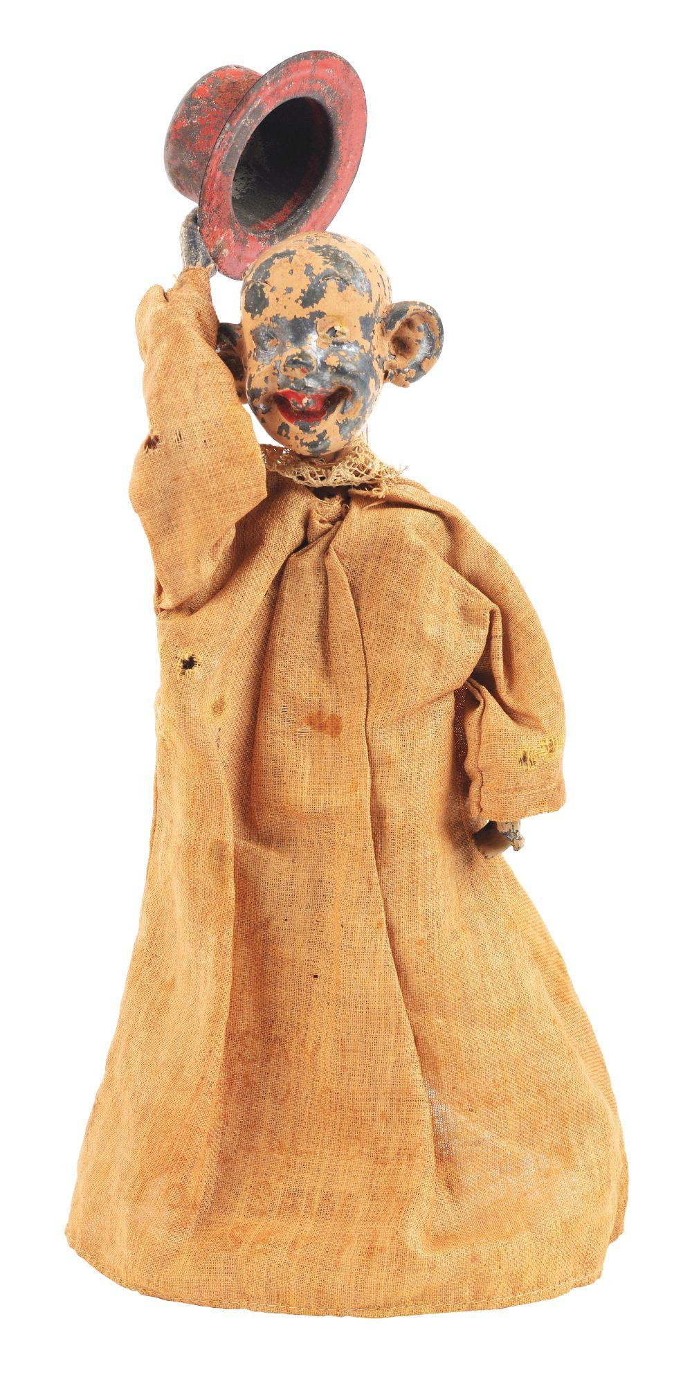 Lot 2364: Very Early Yellow Kid Hat Tipping Toy.