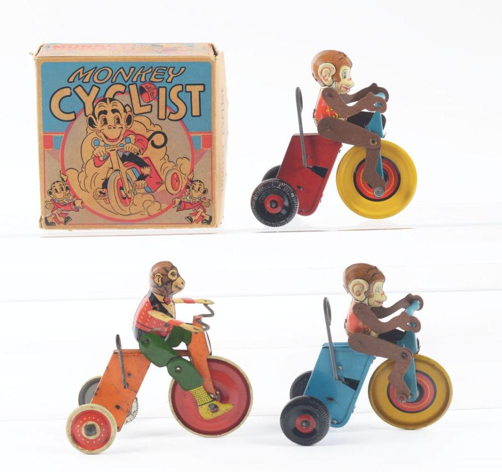 Lot 2376: Lot of 3: Marx Tin-Litho Wind-Up Monkey Cyclist Toys.