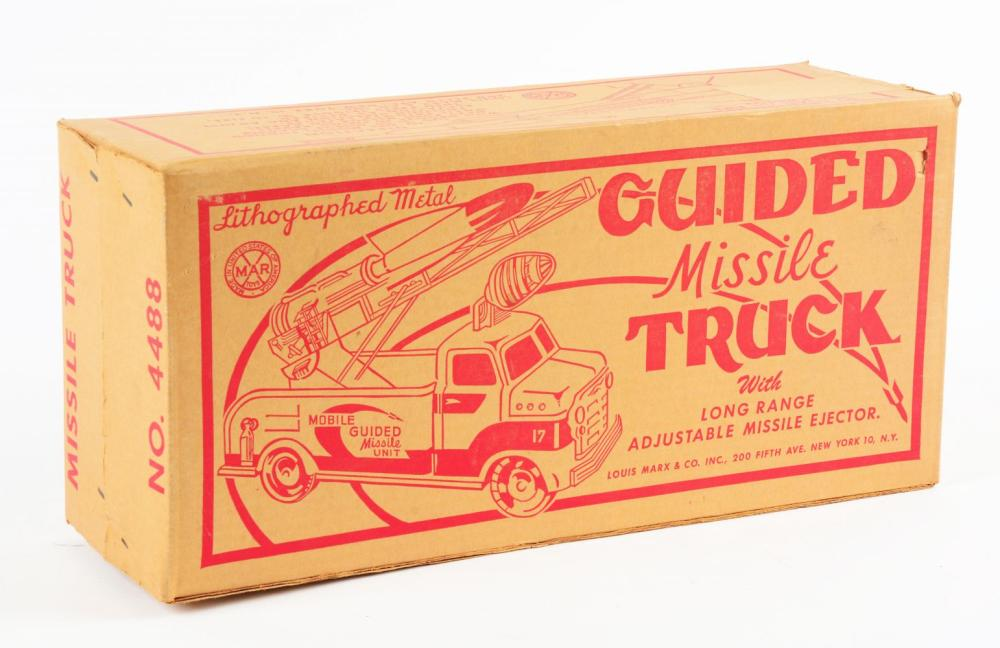 Lot 2386: Sealed Unused Marx Pressed Steel Guided Missile Truck.