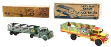 Lot 2392: Lot of 2: Marx Pressed Steel Stake Trailer Vehicles.