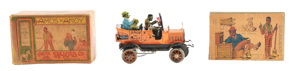 Lot 2414: Marx Tin-Litho Wind-Up Amos & Andy Fresh Air Taxi Toy.