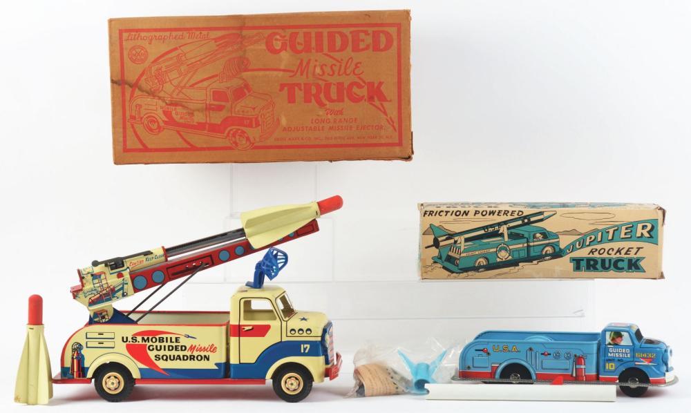 Lot 2421: Lot of 2: Marx Pressed Steel Rocket Launching Trucks.