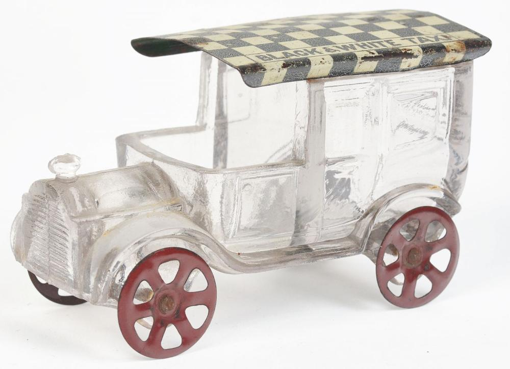 Lot 2468: Black & White Taxi Candy Container.
